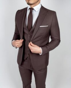 A sleek Dark Brown 3 Piece Suit in a slim fit is an excellent alternative to a traditional black suit. A crisp white shirt or pale blue patterned shirt would pop against the rich brown for a chic look perfect for work or leisure.